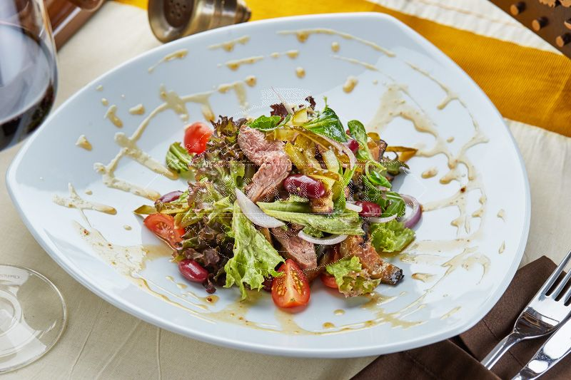 Abramov specialty salad with baked beef and eggplant, sweet honey topping, and mixed salad