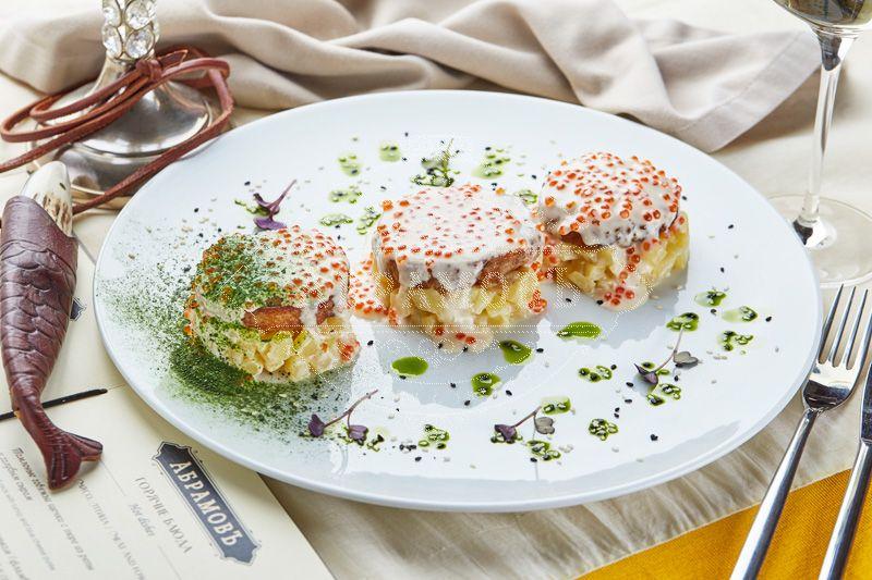 Trio of fish cutlets (pike-perch, carp, pike) in potato risotto with saffron-caviar sauce