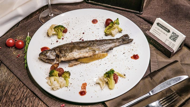 Baked Rainbow Trout Served with Broccoli on Wine,Zucchini and Cherry Tomatoes