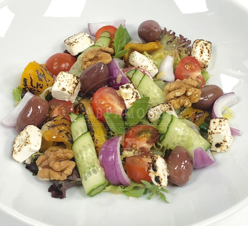 Vegetable salad with baked pepper and seared feta