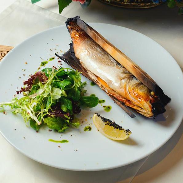 Soft smoked European bass grilled in alder wrap