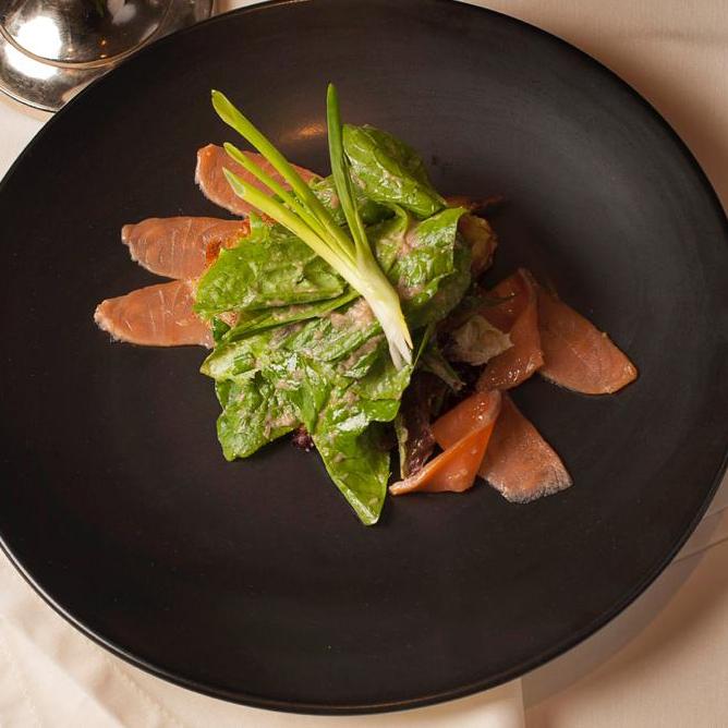 Lightly-salted Atlantic salmon salad with crispy pancakes and wild garlic sauce