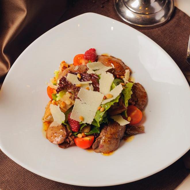 Salad with rabbit liver, cepe mushrooms, fresh raspberries sprinkled with pine nuts