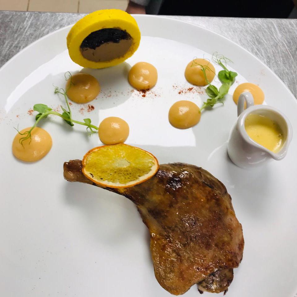 Confit duck leg with orange sauce, foie gras liver pate and onion confit