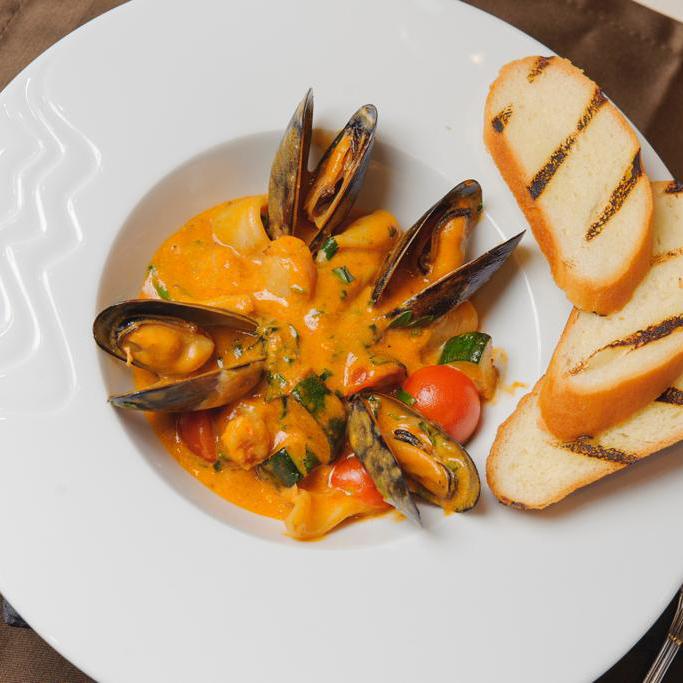 Mediterranean seafood stew in bisque sauce