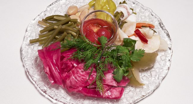 Assorted Siberian pickles (gurian cabbage, wild garlic in salo, sour turnip, in-house salted tomatoes, barrel-salted cucumbers)