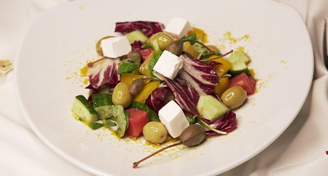 Vegetable salad with delicate brinsen cheese and mixed herbs