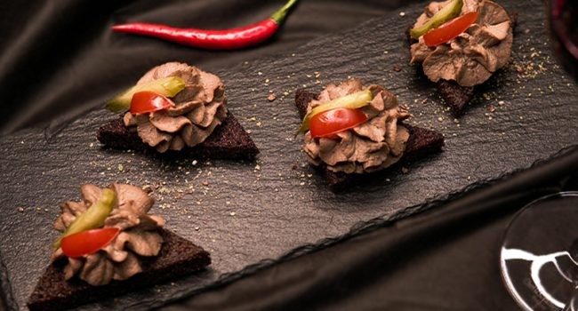 Rabbit liver puree on pumpernickel bread