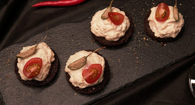 Rillette made of Far Eastern chinook salmon with cream cheese on pumpernickel bread